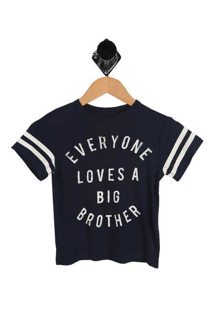 Big Brother Short Sleeve Tee for Little and Big Kids in Navy Blue with white stripes on sleeves. Front graphics say Everyone Loves A Big Brother.  100% Cotton.  Machine Wash Cold, Tumble Dry Low.