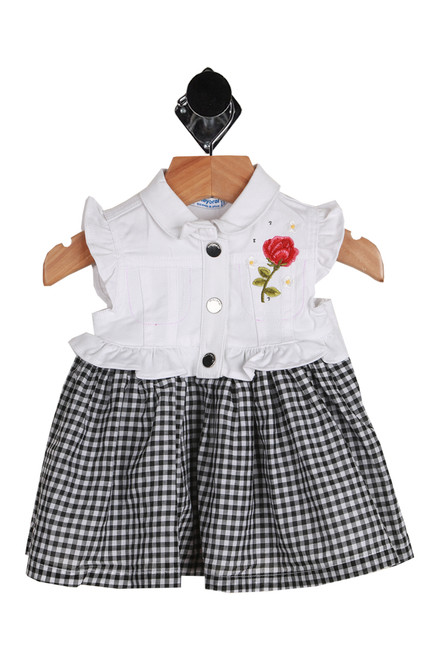 Vichy Dress for Infants Features a black and white gingham skirt and a white  sleeveless blouse with a ruffle at each shoulder.  Has a 3-snap closure at front top and cotton attached skirt is fully lined.  Top Half - 99% Cotton, 1% Elastane, Bottom Half - 100% Cotton.  Machine Wash Cold, Tumble Dry Low.