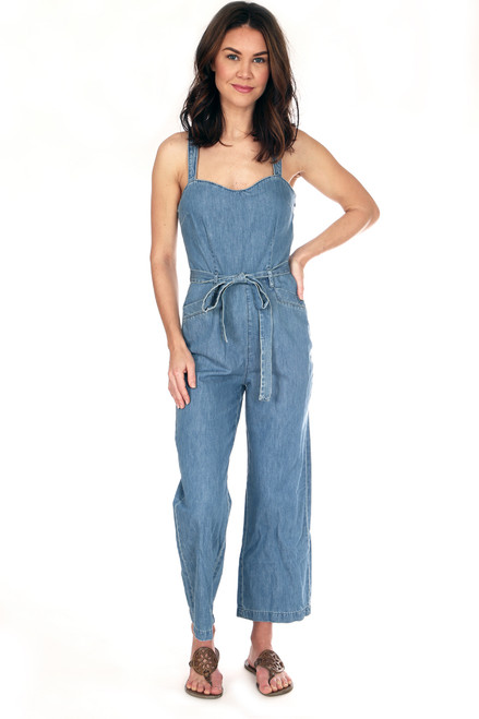 Denim jumpsuit with tie waist fits True To Size.  This jumpsuit has wide spaghetti straps and has a Side Zipper Closure with wide cropped pant. Shoulder To Hem Measurement is  Approximately 52.5 inches.  100% Cotton.  Machine Wash Cold, Hang Dry