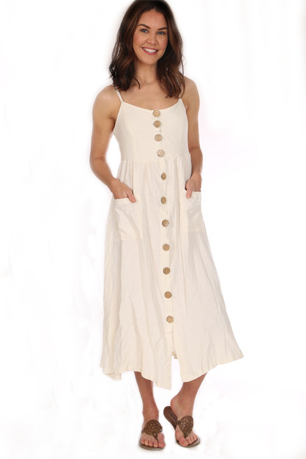 White linen button front midi dress with front pockets.  This dress has Smocked Backing and Adjustable Straps.  Scoop neck front and low back. Fits True To Size.  Shoulder To Hem Measurement is approximately 46 inches.  Fabric Content is 55% Linen, 45% Rayon.  Machine Wash Cold, Tumble Dry Low.