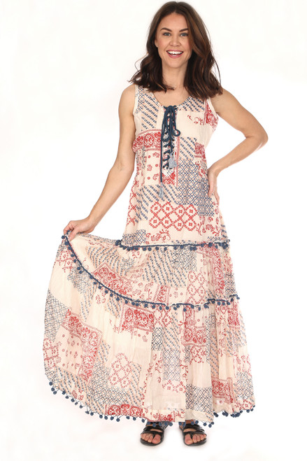 Sleeveless Dixie lace up maxi dress in off white, navy and red.  Tiered skirt which is trimmed with navy pom poms.  Fits True To Size and is lined. Shoulder To Hem Measurement is Approximately 54.5 inches.  100% Cotton.  Hand Wash Cold, Hang Dry or Dry Clean.