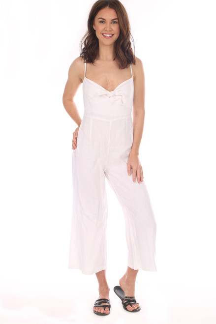 White linen sleeveless jumpsuit with tie top has a Side Zipper Closure and Smocked Backing.  The straps are Adjustable.  Shoulder To Hem Measurement is Approximately 49.5 inches.  100% Linen.  Hand Wash Cold, Hang Dry.