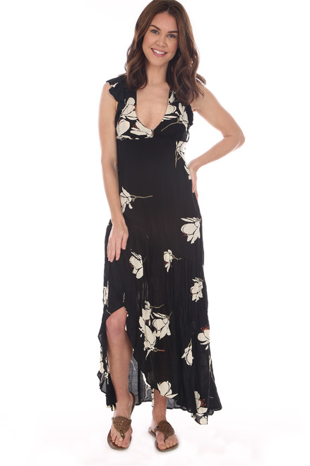 Long sleeveless dress is black with a white flower pattern.  Ruffle at shoulder.  Side Zipper Opening.  Hook & Eye at front V.  Slit on front to just above one.  Shoulder To Hem Measurement is approximately 53 inches at longest point.  100% Rayon.  Machine Wash Cold, Hang Dry.