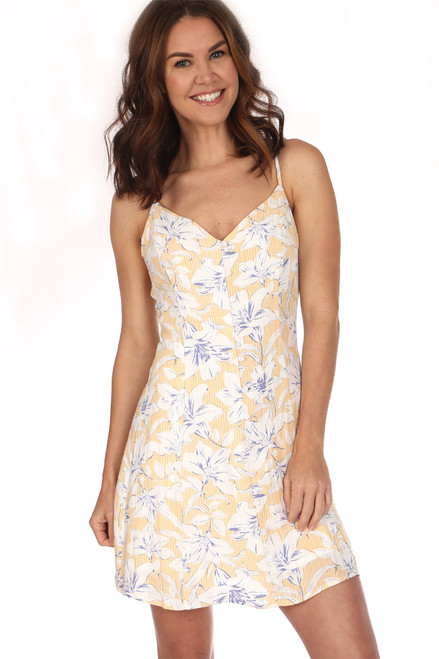 The Luci mini dress is sleeveless with Adjustable Straps and is lined and has buttons down the front.  Pale yellow with white flowers.  It fits true to size Shoulder To Hem Measurement is Approximately 34.5 in. It is 80% Rayon, 20% Nylon and the Lining is 100% Rayon Hand Wash Cold, Line Dry.