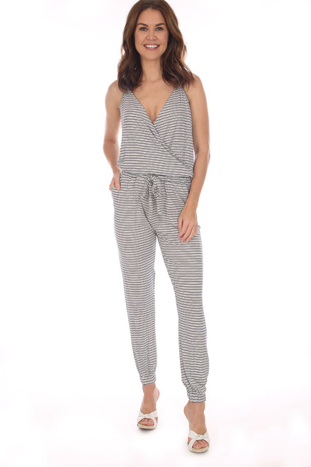 Surplice Striped Jumpsuit in navy and white has a front snap and tie waist with elastic at ankles.  Shoulder To Hem Measurement is Approximately 60 in. Fabric Content is 95% Rayon, 5% Spandex.   Hand Wash Cold, Line Dry.