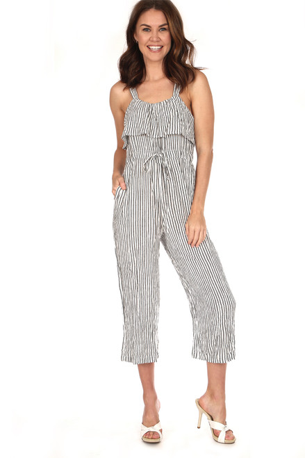 Sleeveless tie waist ruffle jumpsuit in charcoal and white vertical stripes fits true to size and has a tie waist and wide shoulder straps.  Shoulder To Hem Measurement is Approximately 49 in.  Fabric Content: Shell is 100% Rayon and Lining is 100% Cotton.  Hand Wash Cold, Line Dry.