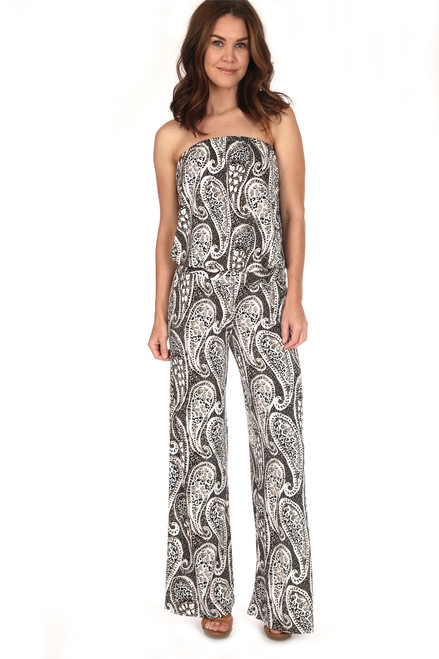 Strapless drop waist jumpsuit in black and white paisley has an elastic waist band and fits true to size.  Shoulder To Hem Measurement is Approximately 56 inches.  Fabric Content is 94% Polyester, 6% Spandex. Machine Wash Cold, Tumble Dry Low.