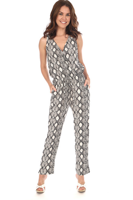 Sleeveless woven surplice front Jumpsuit in black and white snake print has elastic tie waist,  side slit pockets with a v-neck.  Fits true to size.  Shoulder To Hem Measurement is  Approximately 54 inches.  100% Polyester. Machine Wash Cold, Tumble Dry Low.