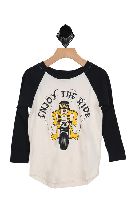 "baseball-style tee with black sleeves and cream body. features ""enjoy the ride"" written in black at front with tiger figure on motorcycle"