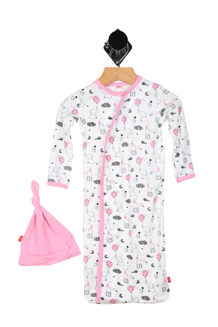 pink sack gown with elephants, moons & clouds printed all over with matching all pink hat