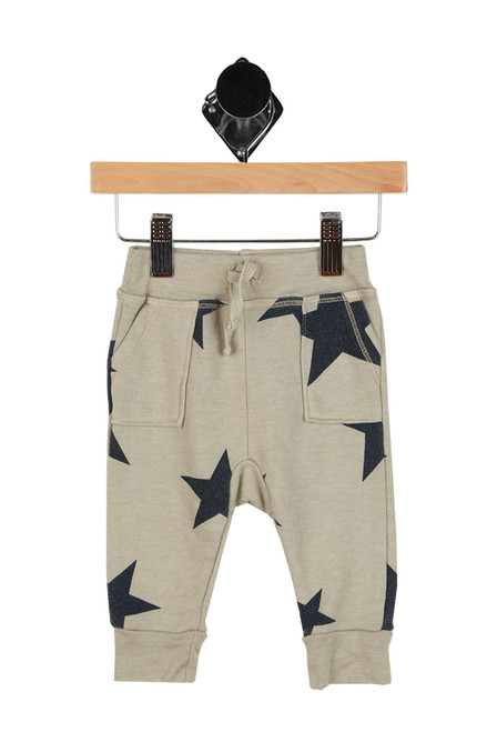 sage green sweat pants with black stars