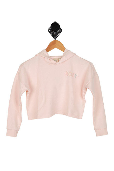 light pink boxy oversized hoodie with ROXY printed at left corner front.