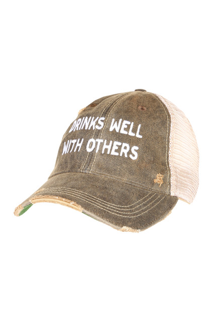 DRINKS WELL WITH OTHERS TRUCKER HAT IN DISTRESSED BLACK