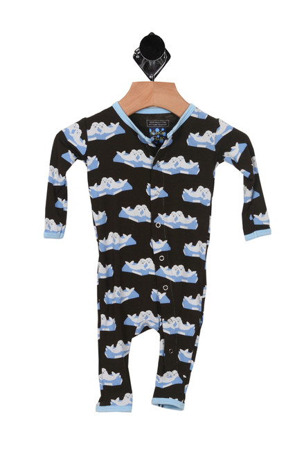 front shows  Classic button up Layette Ruffle Coverall onesie in black color and  printed seals all over.
