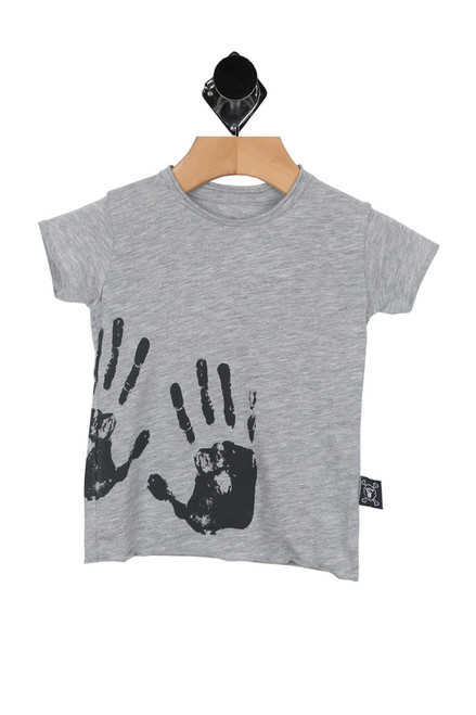 front shows grey tee with two black hand prints at bottom left. True to size, raw hem detail