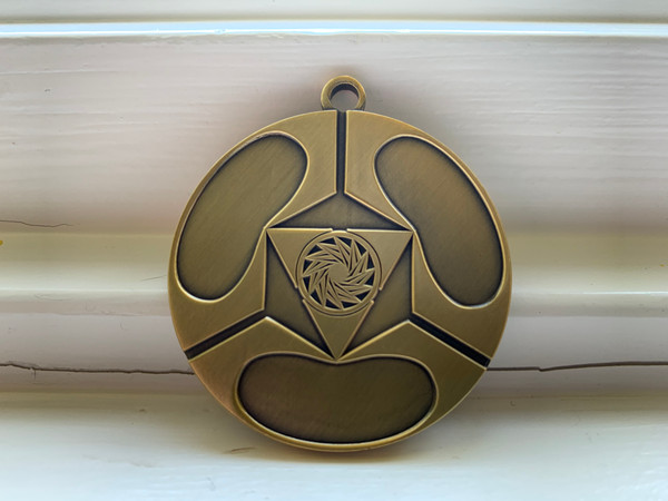 The Healing Spell Amplifier Medallion