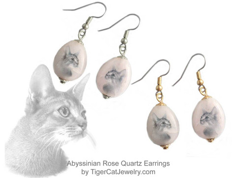 $16.99 Abyssinian Cat ink sketch is featured on Rose Quartz gemstone earrings. Translucent with a pink tint.Trimmed with gold or silver plated metals. Surgical Steel fishhook tops.#AbyssinianCat#AbyCat#AbyssinianCatJewelry#AbyssinianCatEarrings#CatJewelry#PetMemorial#TigerCatJewelry#RoseQuartz