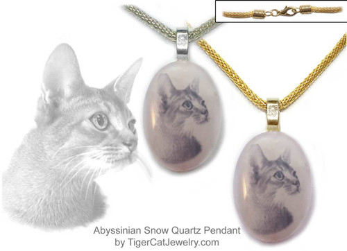 $16.99 A Abyssinian ink sketch is featured on a Rose Quartz photo pendant. Trimmed in gold or silver plated metals. Translucent with a pink tint.#AbyssinianCat#AbyCat#AbyssinianCatJewelry#AbyssinianCatNecklace#CatJewelry#PetMemorial#TigerCatJewelry#rosequartz