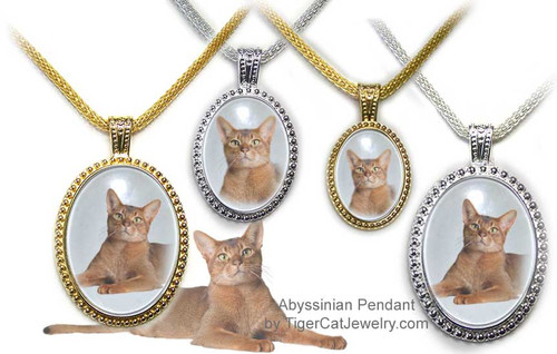 $25.99 Ruddy Abyssinian Cat Ornate Pendant in Silver or Gold has an almost three dimensional look with transparent photo under glass. Three sizes and two colors to choose from with text on back as a free option.#AbyssinianCatJewelry#AbyssinianCat#CatJewelry#TigerCatJewelry#PetMemorial