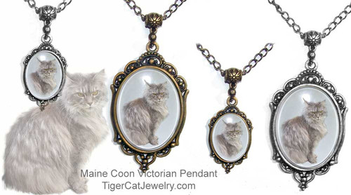 $23.99 Maine Coon Cat photo, is featured on Victorian cat pendant necklace under a glass dome. Optional text on back. A complete line for Maine Coon cat lovers. #MaineCoonCatJewelry#MaineCoonCat#VictorianCatJewelry#MaineCoonCatPendant#TigerCatJewelry#PetMemorial