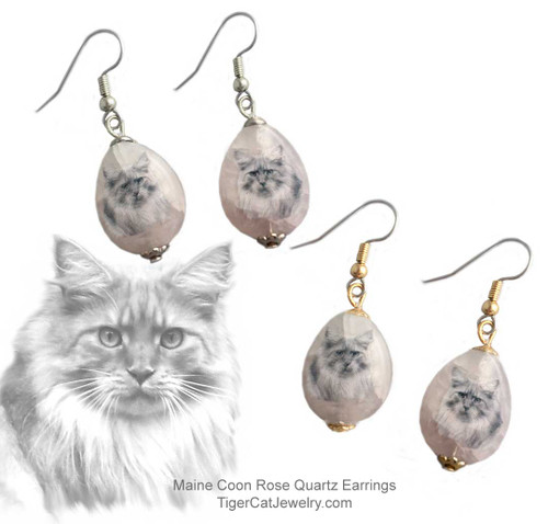 $16.99 A Maine Coon Cat ink sketch is featured on Rose Quartz gemstone earrings. Translucent with a pink tint.Trimmed with gold or silver plated metals. Surgical Steel fishhook tops.#MaineCoonCatJewelry#MaineCoonCat #CatJewelry#MaineCoonCatEarrings#TigerCatJewelry#CatEarrings