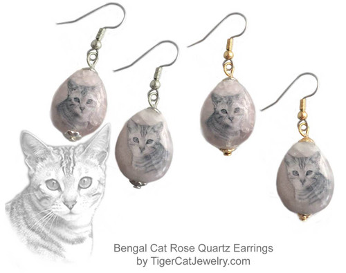 $16.99 A Bengal Cat ink sketch is featured on  Rose Quartz photo Earrings. Trimmed in gold or silver plated metals. Translucent with a pink tint.#BengalCatJewelry#BengalCat #CatJewelry#BengalCatEarrings#TigerCatJewelry#PetMemorial#RoseQuartz