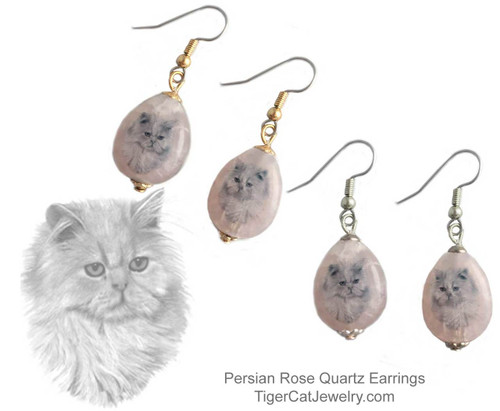 $16.99 A Persian Cat ink sketch is featured on Rose Quartz gemstone earrings. Translucent with a pink tint.Trimmed with gold or silver plated metals. Surgical Steel fishhook tops.#PersianCatJewelry#PersianCaEarringst#CatJewelry#PersianCatPendant#TigerCatJewelry#PetMemorial#rosequartz