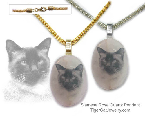 $16.99 A Siamese Cat ink sketch is featured on a Rose Quartz photo pendant. Trimmed in gold or silver plated metals with steel mesh chain. Translucent with a pink tint.#SiameseCatJewelry#SiameseCat#CatJewelry#SiameseCatPendant#TigerCatJewelry#PetMemorial#rosequartz