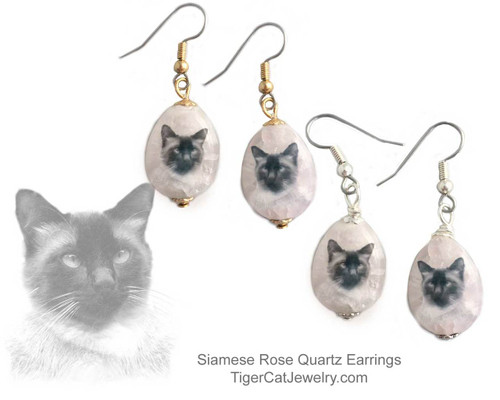 $16.99 A Traditional Siamese Cat ink sketch is featured on Rose Quartz gemstone earrings. Translucent with a pink tint.Trimmed with gold or silver plated metals. Surgical Steel fishhook tops.#SiameseCatJewelry#SiameseCat#CatJewelry#SiameseCatEarringst#TigerCatJewelry#PetMemorial