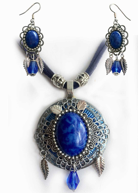 Silver colored Concho pendant with two layers of filigree features a blue faux lapis cabochon with matching earrings.