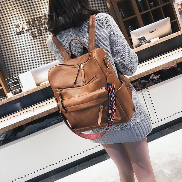 girl in brown backpack
