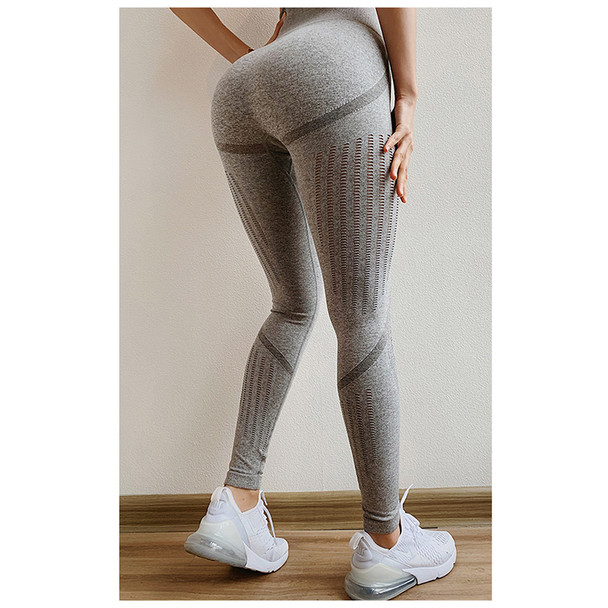 hot girls in gray leggings has a round shaped ass