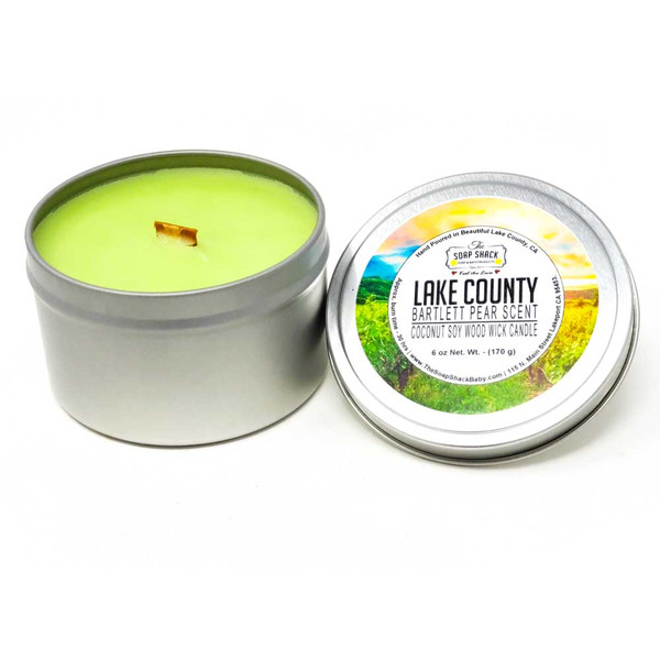 Bartlett Pear scented Woodwick 6 oz soy candle in a tin for easy travel
