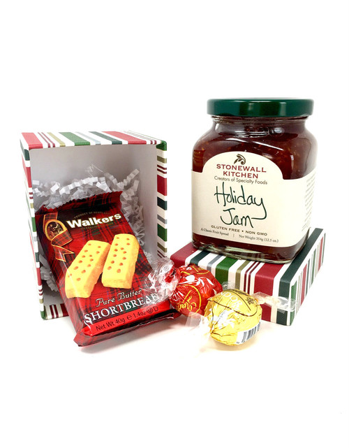 The treats are tucked in the box.  The box and jam are stacked in a cello bag and tied with a coordinating bow.