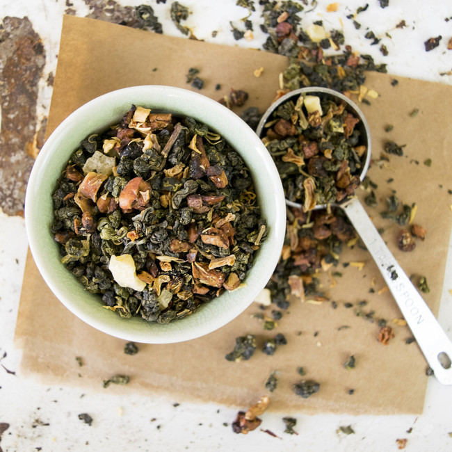 An Xotic Tea Xotics blend of Milk Oolong from the Jin Xuan region in Taiwan with pineapple cubes, carrot flakes, dried apples and marigold blossoms and natural flavor. This blend is a personal favorite of ours and we love it iced also.