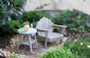 Weathered Lounge Chair and Weathered Wooden Accent Table
