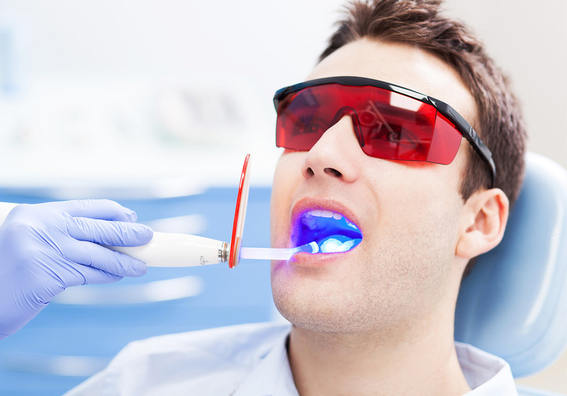 The Effects of Light on Bleaching And Tooth Sensitivity