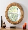 Image of round wavy gold mirror