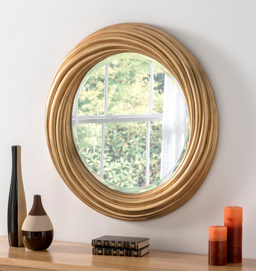 Image of round wavy gold mirror