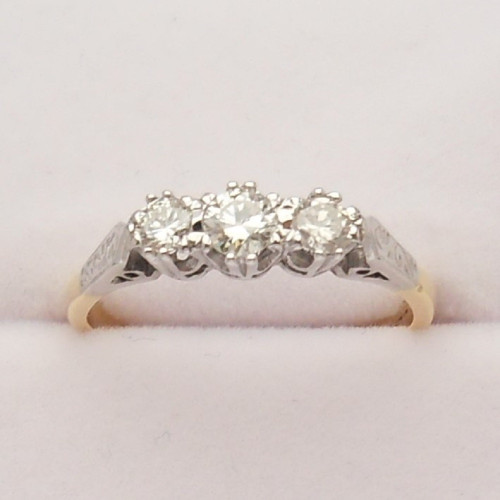 Vintage  3 stone  Diamond set Ring with pretty scroll engraved shoulders marked 18ct size M