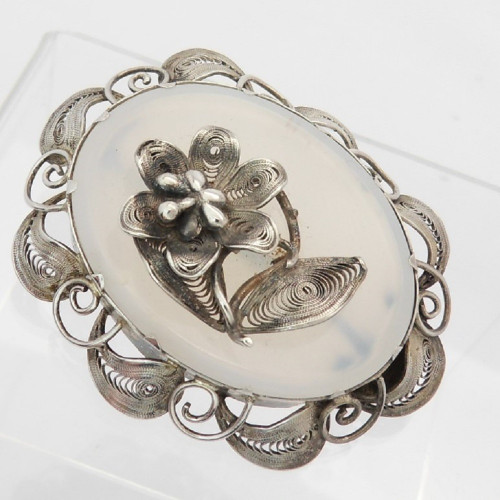 Late Victorian ornate white metal and chalcedony filigree brooch with flower centre