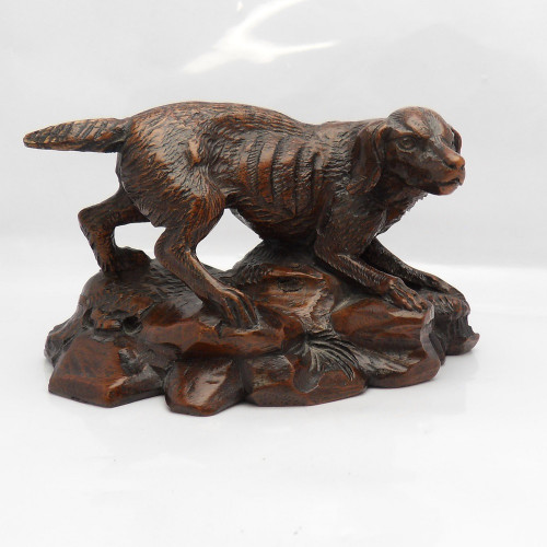 Beautifully carved Black Forest retriever standing on 'Outcrop' base.