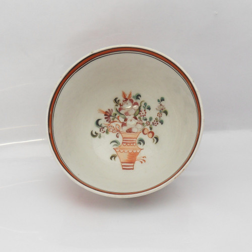 18th Century Newhall Tea Bowl with vase of flowers painted to interior base with striped rim.