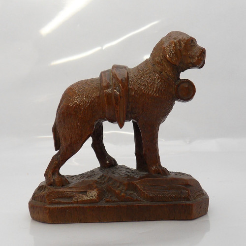 Finely carved antique Black Forest wooden St Bernard Dog with brandy barrel and blanket on carved base