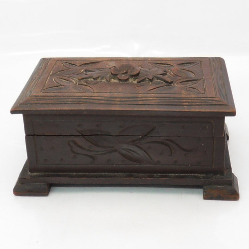 Antique carved Black Forest trinket Casket with purple lined interior