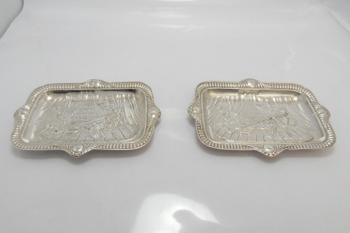 Pair of silver Pin Dishes depicting Sir Walter Raleigh's first pipe in England, hallmarked Birmingham 1897 by  Edward Durban & Co/Johnson, Durban & Co Ltd