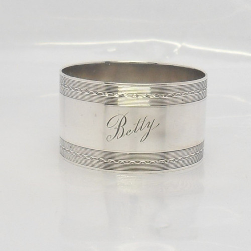 Silver Napkin Ring with engine turned decoration engraved 'Betty' hallmarked Birmingham 1927