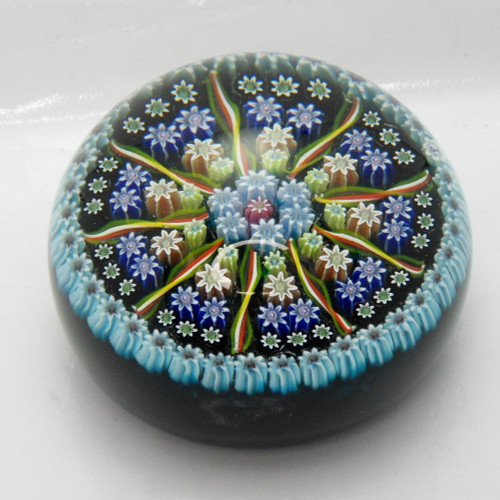 Pretty Perthshire art glass paperweight with spokes and millefiori canes