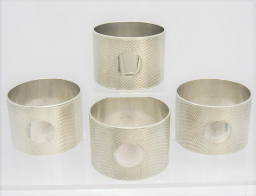 Set of 4 heavy silver Napkin Rings hallmarked London 1944 by  Edward Barnard & Sons Ltd