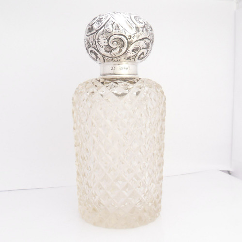 Cut glass silver topped perfume bottle hallmarked Birmingham 1922